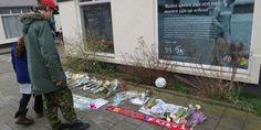 Eerste fans leggen bloemen bij geboortehuis Johan Cruijff