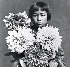 Delightful photo of artist Yayoi Kusama in 1939 already seemingly 'self obliterating' with chrysanthemums.