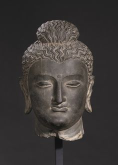 A monumental gray schist head of Buddha, Ancient region of Gandhara, Kushan period, 2nd-3rd century, Height 39.5 cm