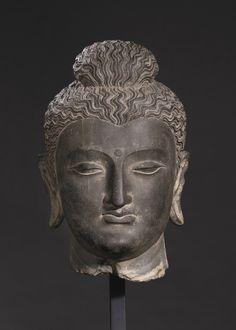 A monumental gray schist head of Buddha, Ancient region of Gandhara, Kushan period, 2nd-3rd century, Height 39.5 cm