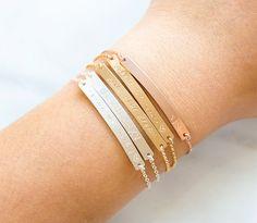Gold Bar Bracelet, Engraved Bracelet, Name Plate, Bridesmaid Jewelry, Rose Gold Filled, Sterling Silver Bar Bracelet by BlushesAndGold on Etsy https://www.etsy.com/listing/252605249/gold-bar-bracelet-engraved-bracelet-name