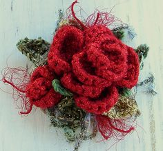 Crochet Boroch Red Rose Glitz - This corsage pin or brooch is made with a sparkle red for the roses. Also with shimmery glitter green and metallic gold for the leaves. Crochet Brooch, Knit Crochet, Crochet Hats, Crochet Things, Dyi Crafts, Yarn Crafts, Knitted Necklace, Corsage Pins, Crochet Wedding