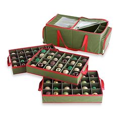 Safely store your treasured Christmas ornaments without compromising their fragility or style in this protective forest green storage bag.