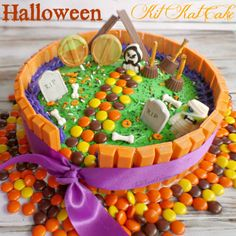 Halloween Kit Kat Cake, Ghostly Graveyard. A great Halloween dessert for any party or just for fun! Great activity to include the kids!