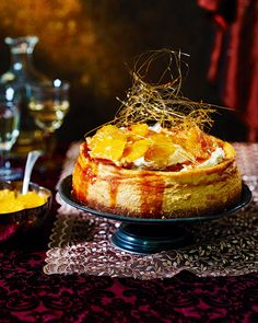 A pudding that deserves a grand entrance. The caramelised oranges, vanilla filling and mascarpone icing make this cheesecake very worthy of its spun sugar crown. Donut Party, Cheesecakes, Cheesecake Recipes, Dessert Recipes, Aperol, Digestive Biscuits, Delicious Magazine, Christmas Desserts, Christmas Lunch