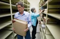 Merrill and Karen Sunderland, of Family Search, look through the last remaining books and files in the State's archives to be photographed on Wednesday. Family Search is a nonprofit family history organization of The Church of Jesus Christ of Latter-day Saints.  Michael Penn | Juneau Empire