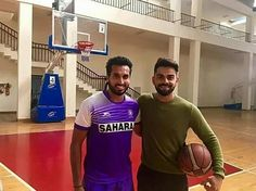 Viray kohli with the Indian Hockley player Dharamvir Singh