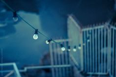 bulbs hanging from a rope by JavierPardina   Stocksy United