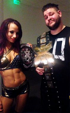 NXT Women's Champion Sasha Banks and NXT Champion Kevin Owens after NXT TakeOver: Rival.