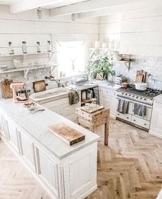 Wooden textures and a neutral colour palette feature in this modern kitchen.