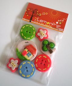 handmade polymer clay buttons.  I love the packaging idea they used!