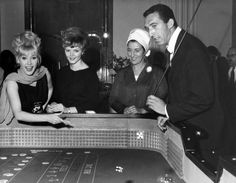 25th August 1965: Gamblers at the Golden Nugget Casino Club in London's Shaftesbury Avenue on its opening night. (Photo by William Vanderson/Fox Photos/Getty Images)