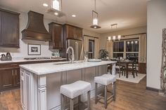 We love this kitchen, with both white and dark stained cabinets!