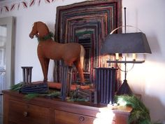love this rug, horse, lamp, stencil on the wall, hell the whole dang display