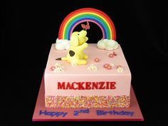 A pretty rainbow cake with Spot the Dog chasing a butterfly in the garden. This cake is white chocolate mud cake with white chocolate ganache filling and covered in fondant. I also made a border of colourful sprinkles to match the rainbow.