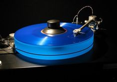 The new Kind of Blue reissue gives a nice blue glow to my Scoutmaster's acrylic platter. Audiophile Turntable, Turntable Record Player, High End Hifi, High End Audio, Platine Vinyle Thorens, Cassette Vhs, High End Turntables, Kind Of Blue, Vinyl Record Storage