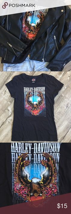Harley Davidson Slim Fit Short Sleeve Blk T-Shirt Black short sleeve slim fitted black Harley-Davidson t-shirt with vibrant colorful signature eagle logo. Reposhing as it was too small for me. Size women's Lg, but fits size 4/6 best so listed as such. Super cute with jeans and leather jacket. No flaws. Reasonable enough price to cut and customize yourself. Concert festival ready! Measurements provided in request. Smoke free seller. No trades please. Tan buckle boots pictured for sale in my…