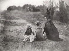 Vintage Photograph of a girl with her dog and donkey.