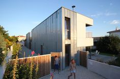 Intergenerational House in France by TICA Architecture | Metal cladding + voids