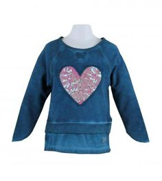 Cotton/spandex unbrushed fleece marble dyed long sleeve top with ribbed neck & waistband, attached inset 100% cotton knit mock undershirt, front sequin trimmed embroidered heart applique and asymmetrical cuffs. Length finishes below hip. Machine washable. Imported.