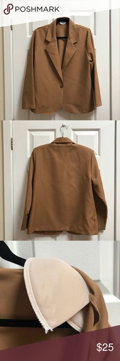 Vintage Camel Blazer This is a great vintage piece from Blair's Boutique!! This blazer is a lovely tan caramel color and has one detailed button to fasten it closed. It also has shoulder pads that can be taken out if desired. The tag says it's a size 14 but I think that it runs a little bit small. It's in amazing condition (it does have some creases but that's because it has been in storage). 🚫 NO TRADES. 🚫 Blair Boutique Jackets & Coats Blazers