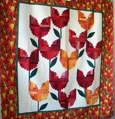 log cabin Holland Tulips