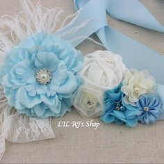 Vintage Inspired Rosette Sash Belt Sashes.  A perfect addition to any outfit for everyday wear or a photo shoot! The total length of the sash including the flowers is approximately 78.  Actual color may be slightly different from pictures due to computer screens resolution, brightness, contrast etc.