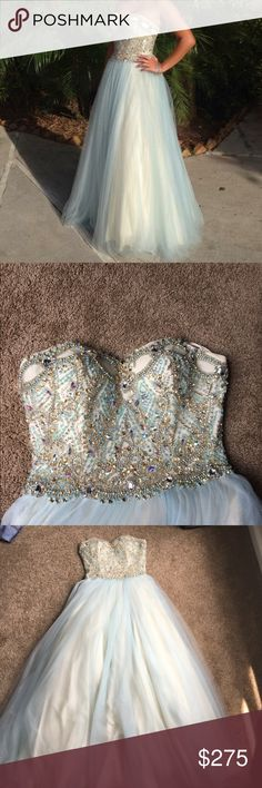 ‼️Cinderella Style Prom Dress ‼️ Slim bodice with sweetheart neckline and zip-up back. Beautifully embellished beading. Tulle Skirt. WORN ONCE. Model is 5'2 and had to wear 6in heels so it's a little long! Light blue tulle, white bodice, off white underlay. A little on the heavier side. Dresses Prom