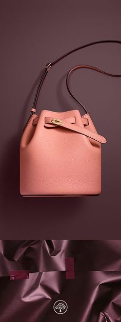 The Abbey is Mulberry's new traditional 'bucket bag' with drawstring detailing, contrast lining and a range of eye-catching or iconic leather finishes. The Abbey features the iconic postman's lock as a nod to Mulberry's heritage DNA, securing a simple belt closure on a timeless, easy to wear style.