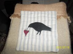 Close up of one of the Crow coasters.  The designs were created using my embroidery machine