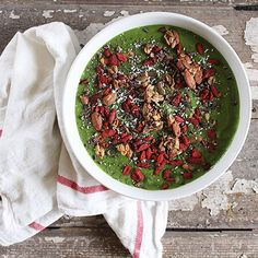 Enjoying my classic Stripped Green Smoothie bowl with additional frozen banana and zucchini, topped with my Maple Banana Nut Granola and goji berries. This is how you make a smoothie into a meal YALL- easy to digest nutrients, protein, fiber, carbohydrates, and a little healthy fat from the granola. | recipe on NS (plus it looks like Christmas) | with McKel of Nutrition Stripped
