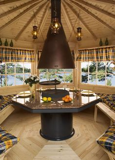 Swanky Octagonal Barbecue Summerhouse Hut Internal showing optional cushion seat pads and curtains Gazebo Foyer, Octagonal Summer House, Casa Octagonal, Indoor Fire Pit, Bbq Hut, Granite Table, Gazebo With Fire Pit, Outdoor Shelters, Design Jardin