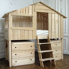 Is it a treehouse or a bed? Either way, it's AWESOME