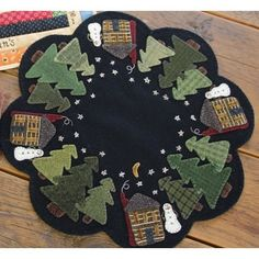 Winter Cabin Table Mat Wool Applique Quilt Pattern makes a small x mat Features snowmen, wood cabins, a forest full of trees and the twinkling stars of a night sky. Wool Applique Quilts, Applique Quilt Patterns, Wool Quilts, Wool Embroidery, Appliqué Quilts, Penny Rugs, Felted Wool Crafts, Felt Crafts, Christmas Tree Skirts Patterns