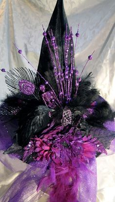 Purple witch hat with peacock feathers