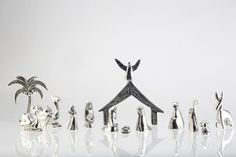 Pin for Later: 8 Not-So-Typical Nativity Scene Sets That'll Spiff Up Your Christmas Polished Pewter Nativity Set This metallic nativity set ($89) is perfect for those who want to keep their holiday decorations polished and elegant.