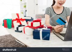 closeup of happy pretty woman holding credit card using e-commerce system online shopping at home with selective focus photo.