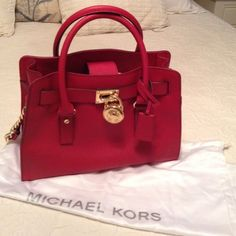Authentic Michael Kors red purse used just a few times it's an eye catcher for sure like new condition Michael Kors Accessories