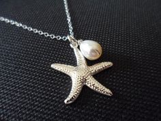 This necklace is made with bright starfish pendant paired with white freshwater pearl wrap in sterling silver wire. Finished with 16 inches