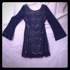Is your dress see through, gypsy? Navy blue lace with nude lining under made of spandex, rayon and polyester of course! If you have knee high boots, you've got an outfit. Never worn. Xhilaration Dresses Long Sleeve