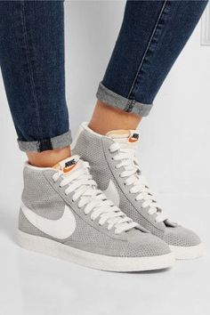 Nike | Blazer perforated suede high-top sneakers | NET-A-PORTER. Nike's 'Blazer' sneakers were originally designed as a basketball shoe in the '70s and have since grown to become a cult classic. This perforated gray suede version will make the perfect finishing touch to weekend looks. We like how the orange rubber sole creates a flash of color as you walk. #sneakerhead