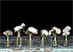 daisies in vases for the tables at the reception