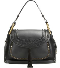 Chloé - Hudson leather shoulder bag - Fuelling our obsession with the soft, bohemian look of the season, Chloé's 'Hudson' shoulder bag is finished with textural braiding and an understated tassel. The smooth black leather piece also features gold-tone hardware and studs for a glamorous vibe. Style over your shoulder on busy days. seen @ www.mytheresa.com