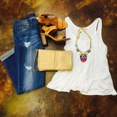 The perfect Daytime outfit!!! Boyfriend fit jeans and simple white tank with chunky necklace and heels ~ the muddy pearl