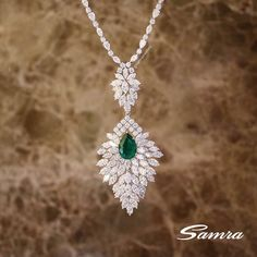 A timeless necklace with a pear cut emerald with diamonds #SamraHighJewellery #SamraJewellery
