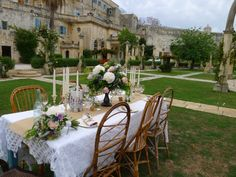 the beautiful Villa in the background Beautiful Villas, Wedding Venues, Wedding Ideas, Wedding Planner, Table Decorations, Bologna, Malta, Chairs, Weddings