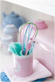 Pretty pastel kitchenware. We love the colourful whisk!