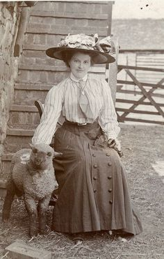 Lady in a big hat with a lamb
