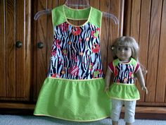 Matching aprons for girl and 18 Doll  zebra by EverSewSweet at etsy.