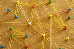 Love this image: Networking and teamwork concept with an interconnected network formed with colorful pins in a cork board connected by elastic rubber bands, background view from above - By stockarch.com user: freebie.photography
